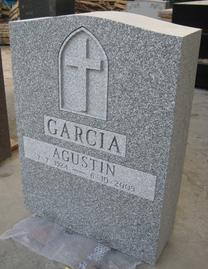 Grey tombstone with cross